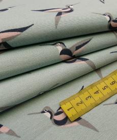 Tissu décoration Ottoman imprimé hirondelles sur fond menthe