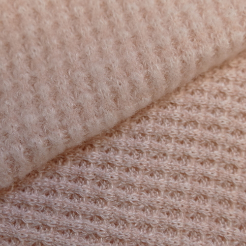 Jersey maille tricotée grattée rose tendre (1.5€/10cm)