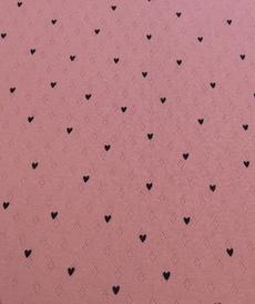Jersey tricot de coton ajouré rose à coeurs noirs (1.45€/10cm)