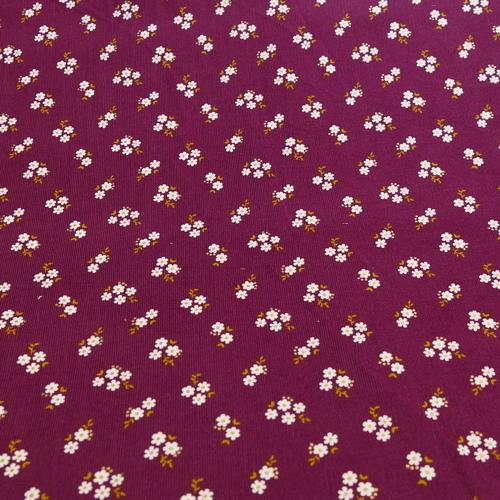 Tissu coton fines côtes prune petites fleurs blanches avec dorures (1.99€/10cm)