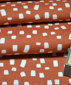 Tissu coton imprimé fond brique Stenzo (0.9€/10cm)