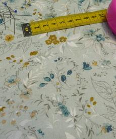 Tissu coton viscose imprimé fleuri vert tendre A la Ville by Bittoun (10cm/2.71€)