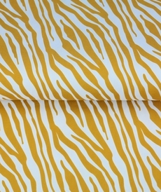 Tissu coton imprimé zébrés fond ocre Stenzo (0.9€/10cm)