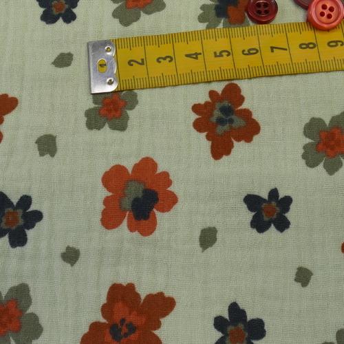 Double gaze de coton vert tendre imprimé petites fleurs (1.20€/10cm)