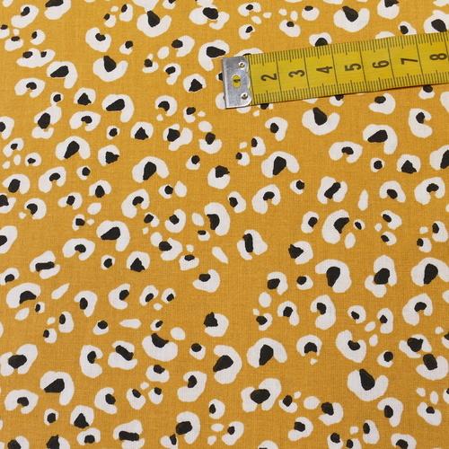 Tissu cretonne imprimé lépoard safran noir ( 10cm/0.85€)