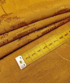 Tissu jacquard en viscose japonisante ocre (10cm/2.6€)