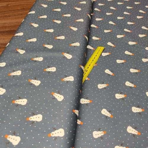 """Tissu coton imprimé """"bonhomme de neige"""" fond marine (10cm/0.9€)"""