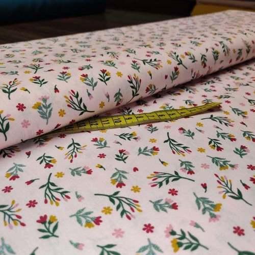Tissu coton popeline imprimé petites fleurs à brillants rose (10cm/1.0€)