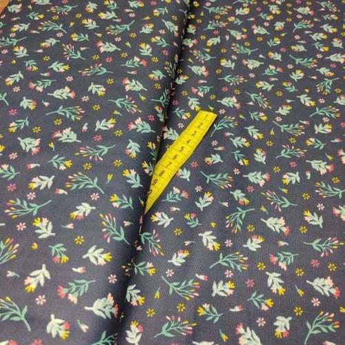 Tissu coton popeline imprimé petites fleurs à brillants marine (10cm/1.0€)