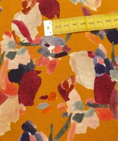 Jersey viscose imprimé DI fond ocre orangé ( 10cm/1.39€)