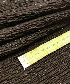 Maille jacquard fantaisie à relief noir brillant ( 10cm/2.69€)