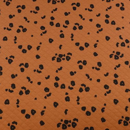Jersey maille jacquard moucheté brique ( 10cm/1.6€)