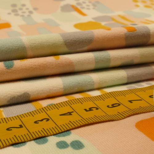 Jersey sweat gratté GOTS imprimé rose tendre/gris/ocre (10cm/1.70€)