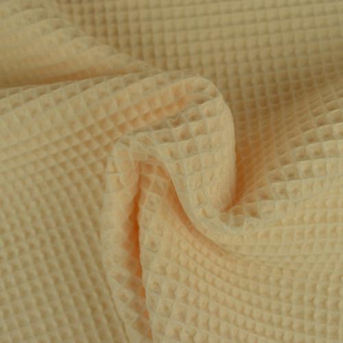 Tissu éponge nid d'abeilles coton champagne