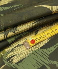 Softshell dino vert vif (1.6€/10cm)