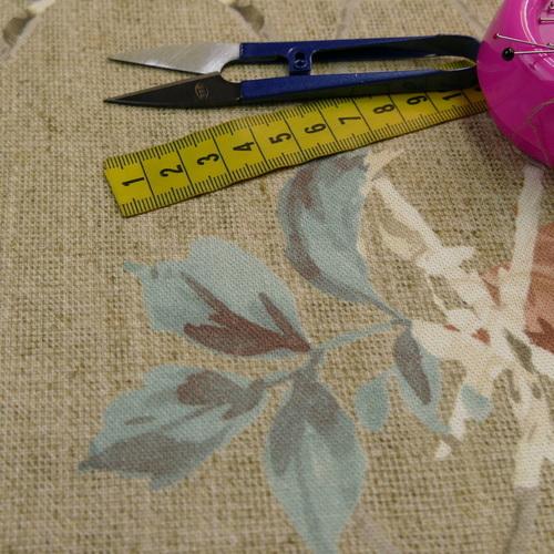 Coton panama kaki marron fond fleuri
