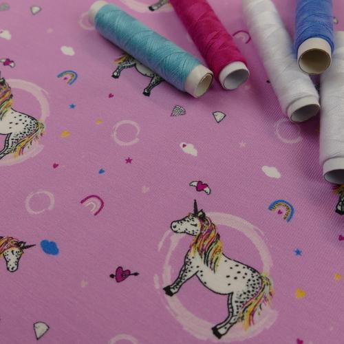 Jersey de coton Licorne sur fond rose d'Hilco