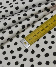 Jersey de coton blanc à pois noir GOTS (1.35€/10cm)