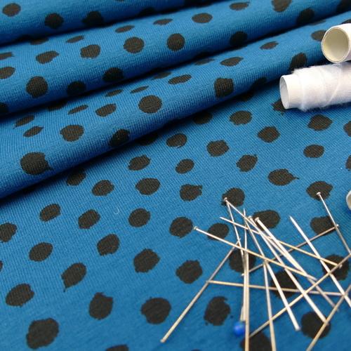 Jersey de coton bleu à pois noir GOTS (1.35€/10cm)