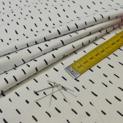 Jersey de coton blanc à traits noirs GOTS (1.35€/10cm)