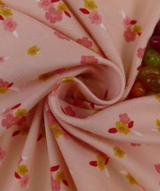 Jersey de coton GOTS rose à petites fleurs romantiques (6.75€/50cm)