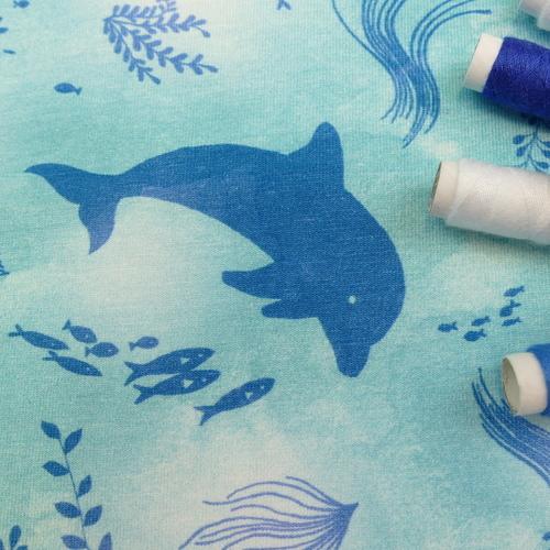 Jersey de coton dauphins sur fond bleu ciel Hilco