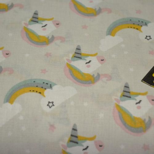 Tissu coton imprimé têtes de licornes sur fond gris perlé