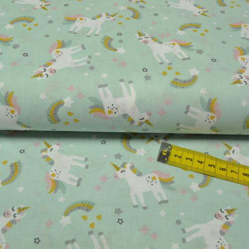Tissu cretonne imprimé licornes sur fond menthe
