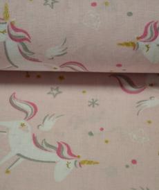 Tissu coton imprimé licornes sur fond rose à pointes dorées (3.5€/50cm)