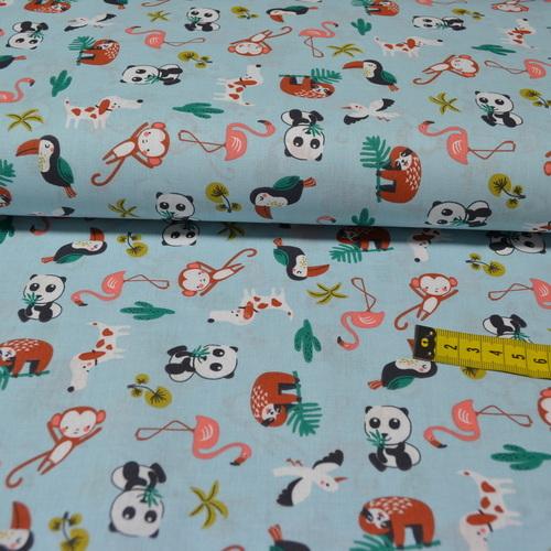 Tissu coton imprimé animaux exotiques sur fond bleu (3.5€/50cm)
