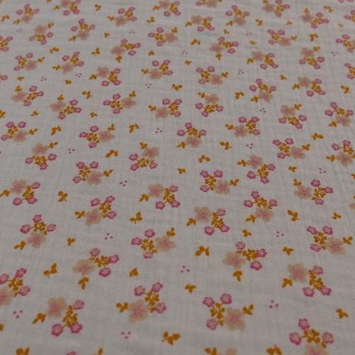 Double gaze de coton gris clair à petites fleurs (1.1€/10cm)