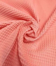 Tissu éponge nid d'abeilles coton corail (1.15€/10cm)