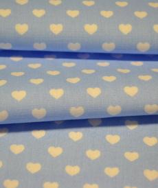 Coton coeur blanc fond bleu bébé