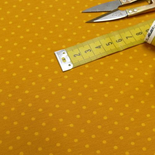 Jersey de coton à pois couleur ocre (1.15€/10cm)