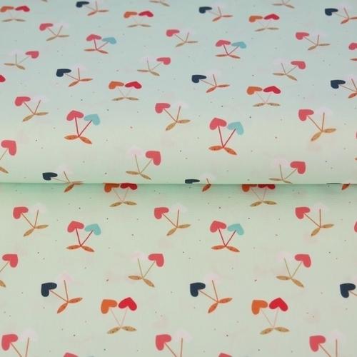 Tissu coton imprimé cerises en coeur fond menthe Stenzo (0.9€/10cm)
