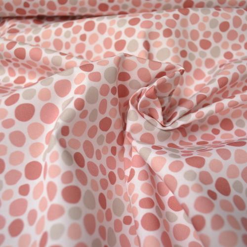 Tissu coton imprimé galets roses Stenzo (0.9€/10cm)