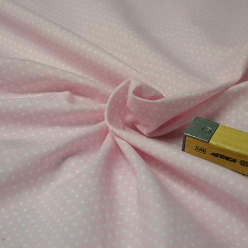 Tissu coton imprimé petits pois sur fond rose